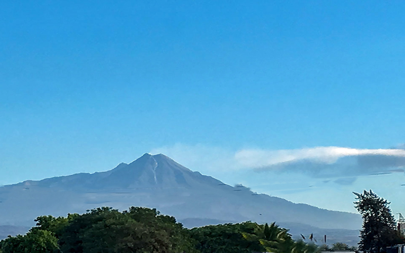 Colima Volcano on a clear blue-sky morning